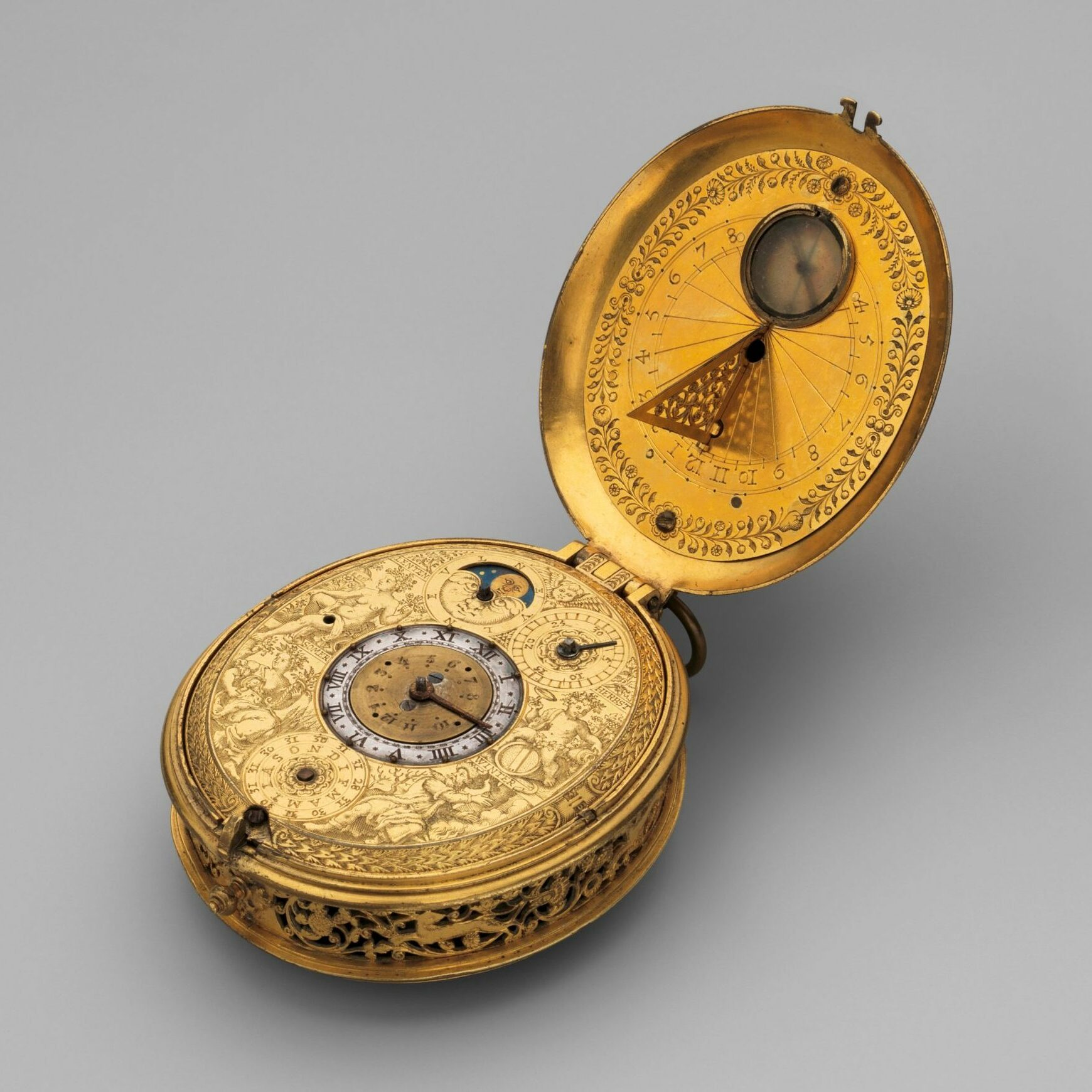 Jan Jansen Bockeltz (died 1626) Clock-watch with sundial, ca. 1605–10 Dutch, Haarlem,  Movement of gilt brass and steel, partly blued; case of gilt brass; H. 2-5/8 x W. 2-1/8 in.  (6.7 x 5.4 cm) The Metropolitan Museum of Art, New York, Gift of J. Pierpont Morgan, 1917 (17.190.1603) http://www.metmuseum.org/Collections/search-the-collections/194191